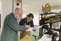 Photo of artist and printing press