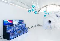 Photo of blue water tanks and white machine