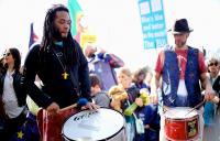 A photo of two men drumming at an anti-Brexit protest