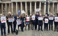 People standing outside the British Museum holding placards