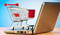 Photo of shopping trolley on laptop