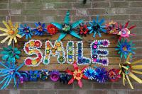 """A """"Smile"""" sign made using crafts by students"""
