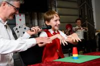 Photo of child doing trick with cups