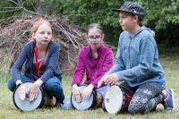 Three children playing drums