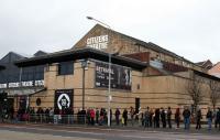 A photo of a queue of people outside Citizens Theatre, Glasgow