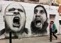 Photo of graffiti - two men shouting