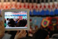 Photo of someone filming a children's concert on an iPad