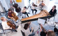 small chamber orchestra performing with period instruments