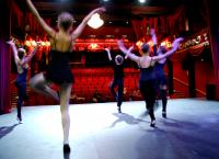 Photo of dancers rehearsing on stage