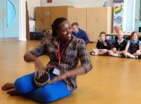 Image of  Lillian Mbabazi leading a school workshop in Blackpool