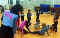 Photo of children in dance class with teacher