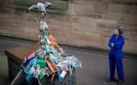 Artist Gail Dooley stands next to her sculpture at The Liverpool Plinth