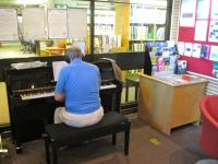Image of pianist in library