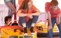 Young people performing on dodgems