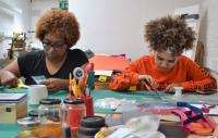 Photo of Craftspace. Two young people doing craftwork