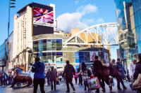 Photo of a full motion screen in Birmingham with Olivier's artwork on