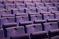 Photo of purple auditorium seats