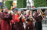 A photo of people dressed as pirates playing brass instruments
