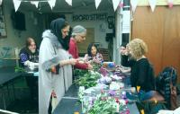 A group of people working on floral displays