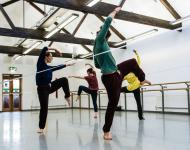 Photo of three dancers in studio