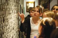 Students gathered around a display at the National Holocaust Centre and Museum
