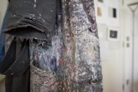 Photo of paint covered coat in artist studio