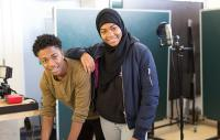 Two young people in a recording studio