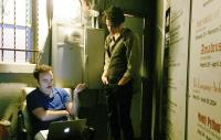 Photo of two actors discussing an audience member's question via laptop
