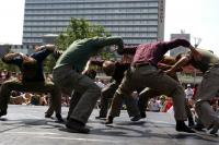 Photo of men dancing in city square