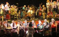 Photo of musicians and singers on stage