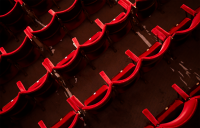 Bird's eye view of unoccupied red theatre seating