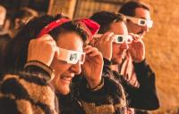 Photo of people wearing 3D glasses