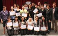 Photo of people with certificates