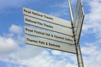 A photo of a signpost directing to the National Theatre, Festival Hall, and others