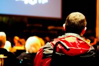 Photo of a man in a wheelchair in an auditorium