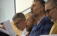 Photo of men singing