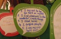 Cardboard apple with 5 midfulness tips written on it
