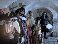 Photo of people dressed in costume in a vaulted room