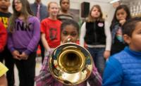 Photo of child playing trumpet