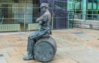 A sculpture of The Ulster Brewer or Barrel Man 1997 By Ross Wilson