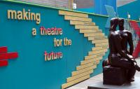 Southbank centre with statue situated in front of a wall displaying the words 'making a future for the theatre'