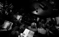 black and white aerial view of an audience by the side of the stage at The Almeida