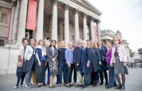 A photograph of people on steps in front of the National Gallery