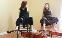 two girls playing the Cello