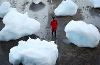 A woman surrounded by blocks of ice