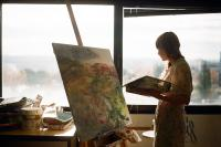 Photo of a woman painting