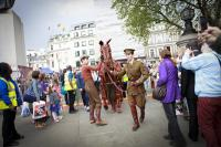 A horse puppet is paraded through the West End of London
