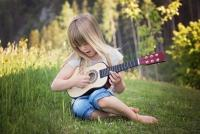 Photo of child playing music