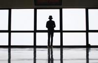 Photo of man standing by window