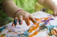 Photo of a child finger painting
